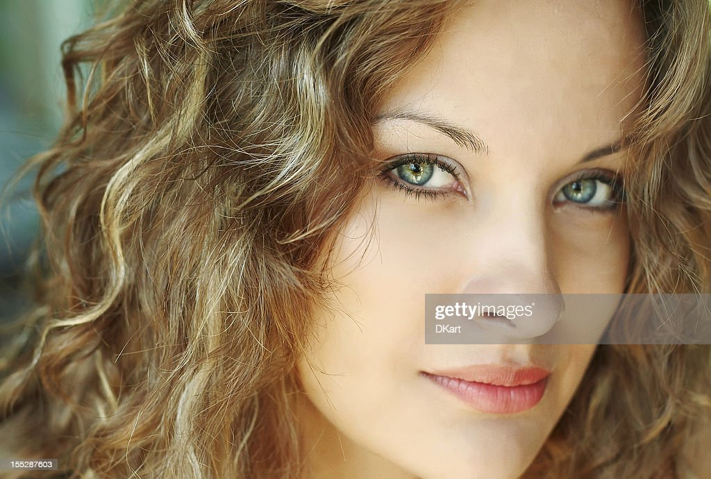 Close-up face of beautiful caucasian blonde woman with green eye : Stock Photo