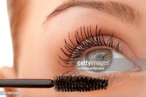 Close-up female applying mascara