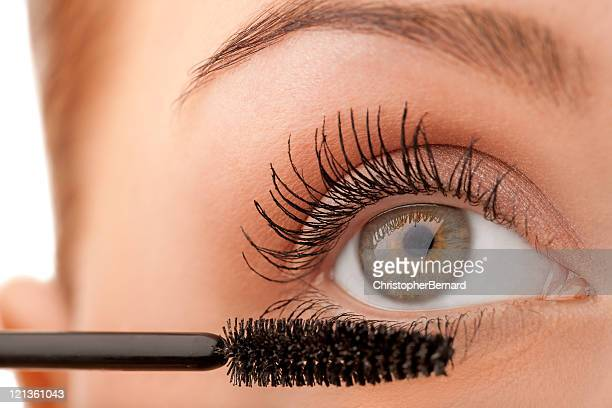 Close-up female applying mascara