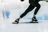 closeup girl legs of speed skater
