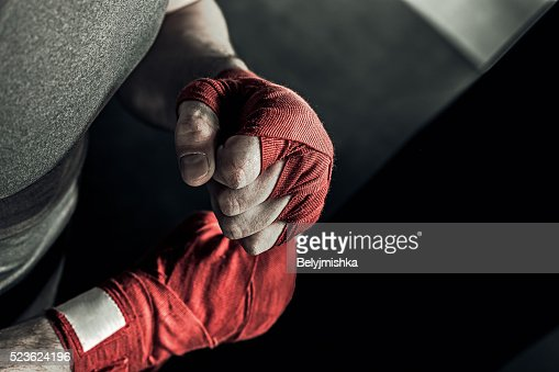 Closeup hand of boxer with red bandages : Stock Photo