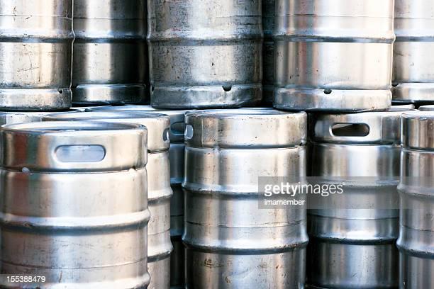 Closeup heap of shiny stainless steel beer kegs