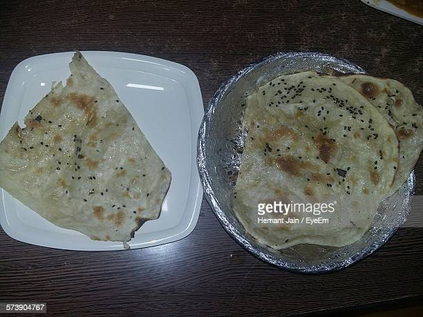 Close-Up High Angle View Of Rotis On Table