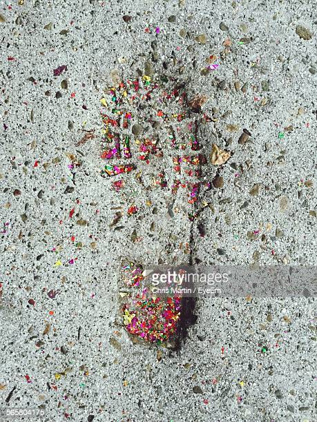 Close-Up High Angle View Of Shoe Print On Sand