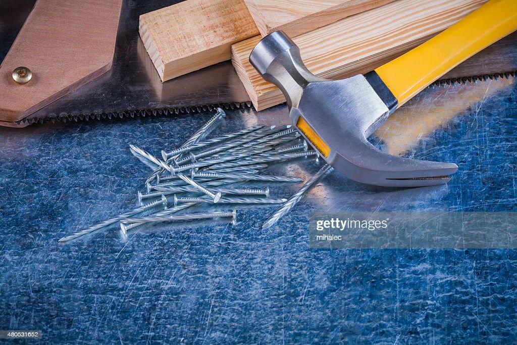Close-up image of metal nails hammer wooden bricks hacksaw : Stock Photo