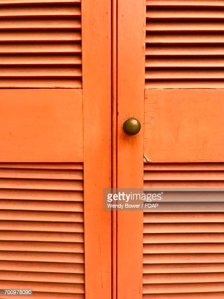Close-up knob on orange shutters
