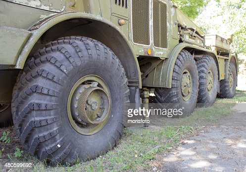 Closeup left side front of a military car : Stock Photo