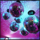 Close-up low angle view of hanging disco balls