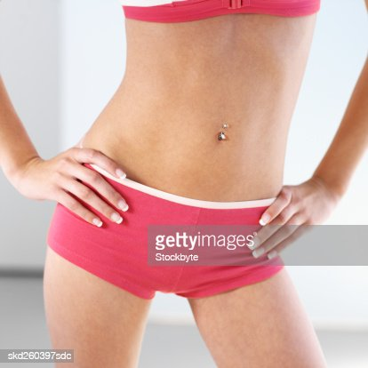 Close-up mid section of a woman standing : Stock Photo
