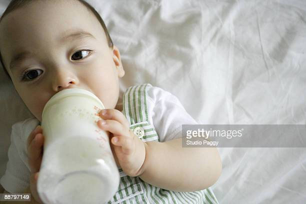 Close-up of a baby boy drinking milk