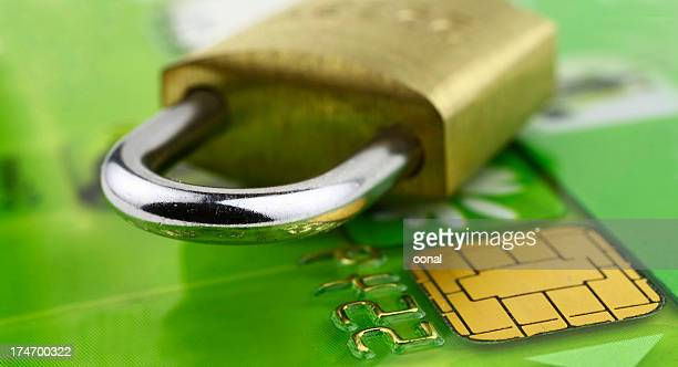 A close-up of a bank chip card with a lock on it