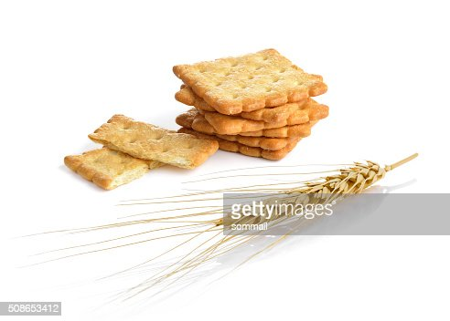 Closeup of a barley ear and Cracker isolated : Stock Photo