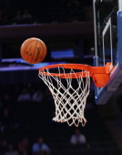 A closeup of a basketball and rim prior to the game between the New York Knicks and the Indiana Pacers at Madison Square Garden on November 20 2013...