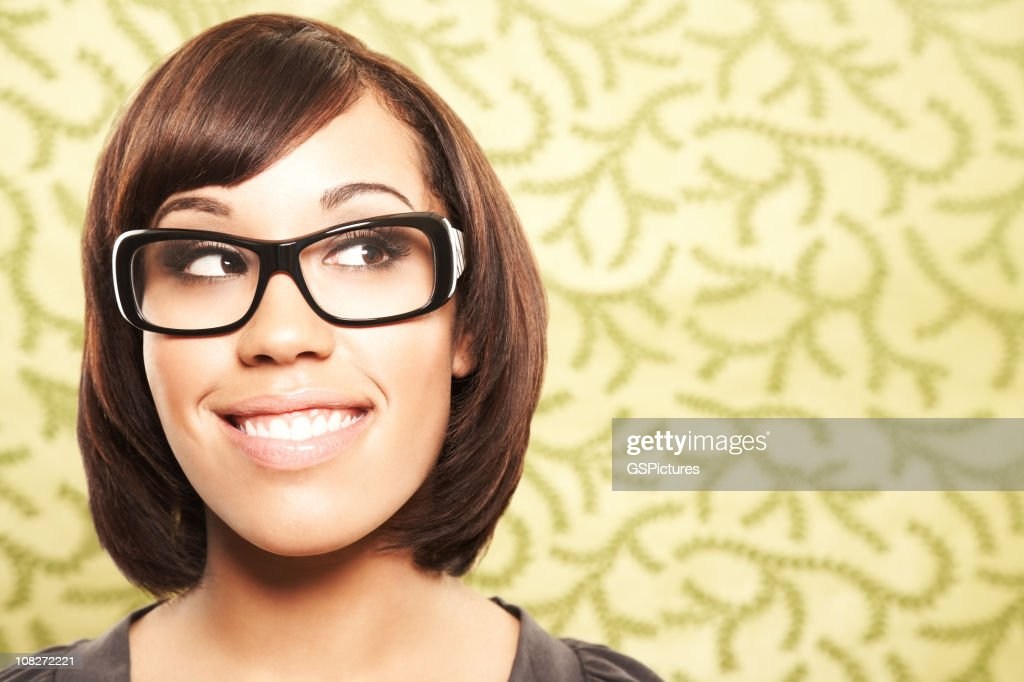 Close-up of a beautiful woman with glasses looking sideways : Stock Photo