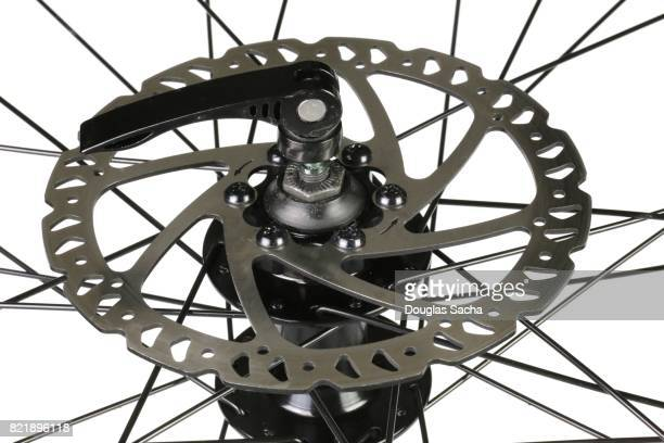 Close-up of a bicycle wheel with wire spokes and brack rotor