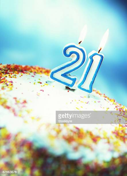 close-up of a birthday cake with a 21 candle on it