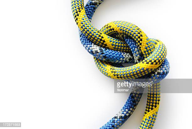 Close-up of a blue and yellow knot on white background