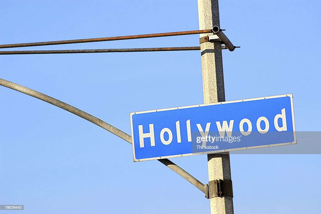 Close-up of a blue street sign on a lamppost for Hollywood. : Stock Photo
