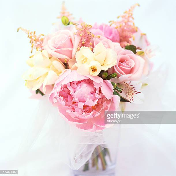 close-up of a bouquet of pink and yellow roses