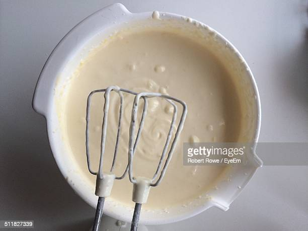 Close-up of a bowl of batter with hand mixer