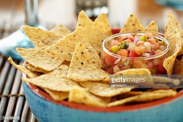 A close-up of a bowl of chips and salsa