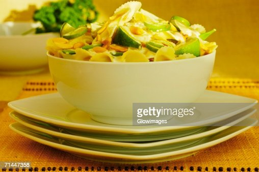 Close-up of a bowl of pasta on a stack of plates : Stock Photo