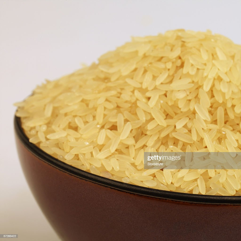 Close-up of a bowl of uncooked rice : Stock Photo