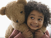 Close-up of a boy carrying teddy bear on his back