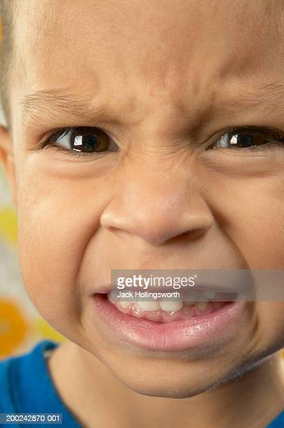 Close-up of a boy gritting his teeth