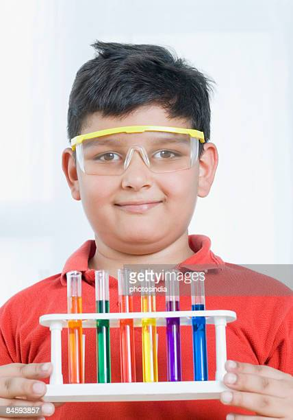 Close-up of a boy holding a test tube holder