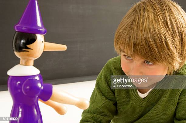 Close-up of a boy looking at a toy
