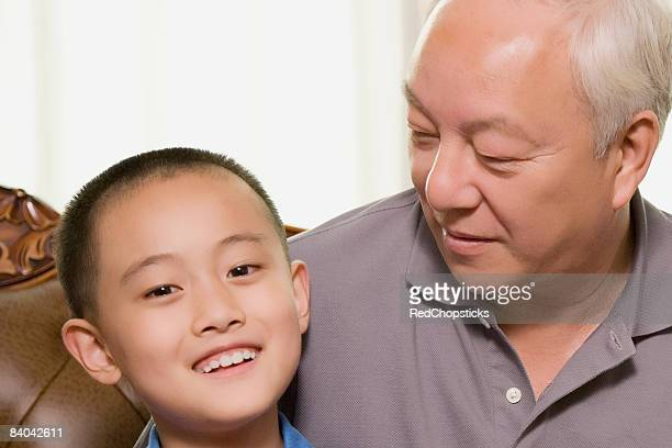 Close-up of a boy smiling with his grandfather