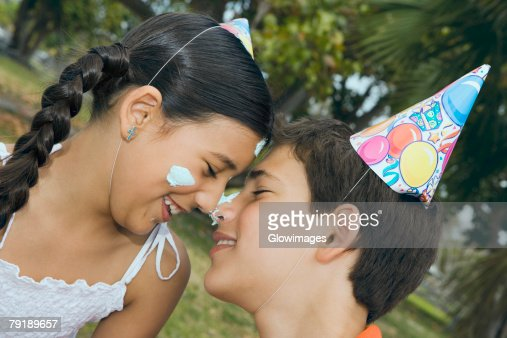Close-up of a boy smiling with his sister : Stock Photo