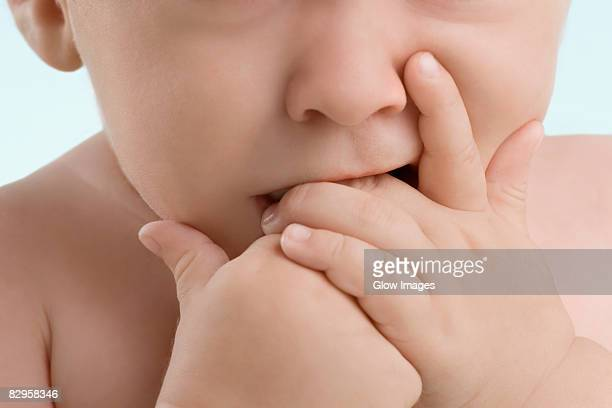 Close-up of a boy sucking his fingers