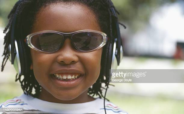 close-up of a boy wearing headphones