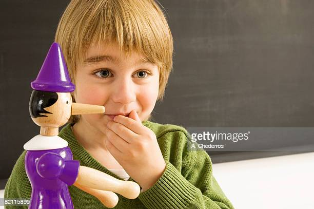 Close-up of a boy with a toy