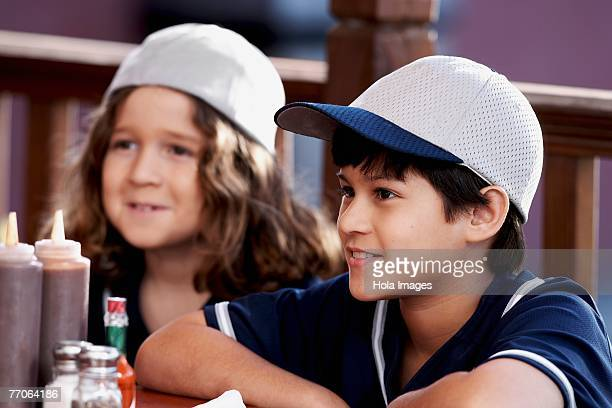 Close-up of a boy with his sister in a restaurant