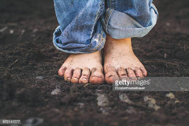 Close-up of a boy's dirty feet