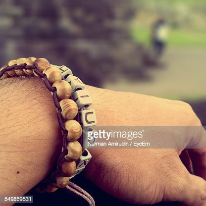 Close-Up Of A Bracelet On Mans Wrist