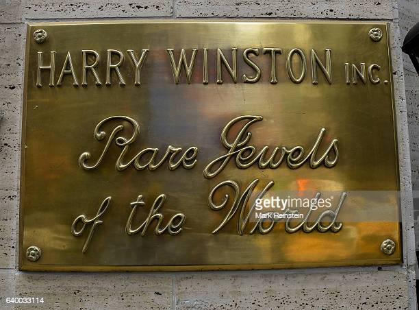 Closeup of a brass plaque on the wall outside Harry Winston's Inc a luxury jeweler New York New York January 10 2017 Under the company name it reads...