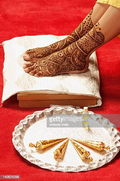 Close-up of a bride's feet with henna decoration