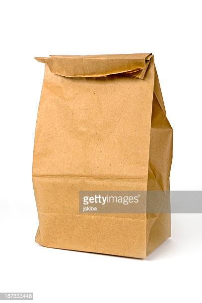 Closeup of a brown paper bag lunch isolated on white