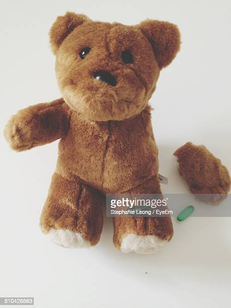 Close-up of a brown stuffed toy over white background