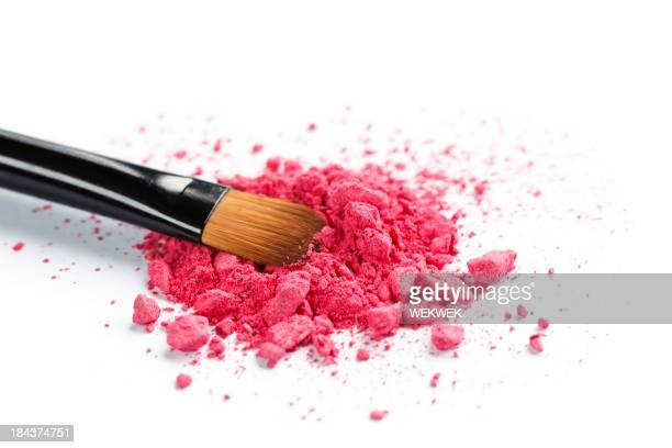 Close-up of a brush laying in crushed cosmetics