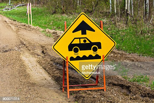 Closeup of a bumpy road ahead sign : Stock Photo