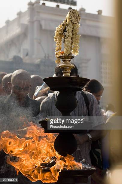 'Close-up of a burning oil lamp, Tirupati, Tirumala Venkateswara Temple, Tirumala, Andhra Pradesh, India'