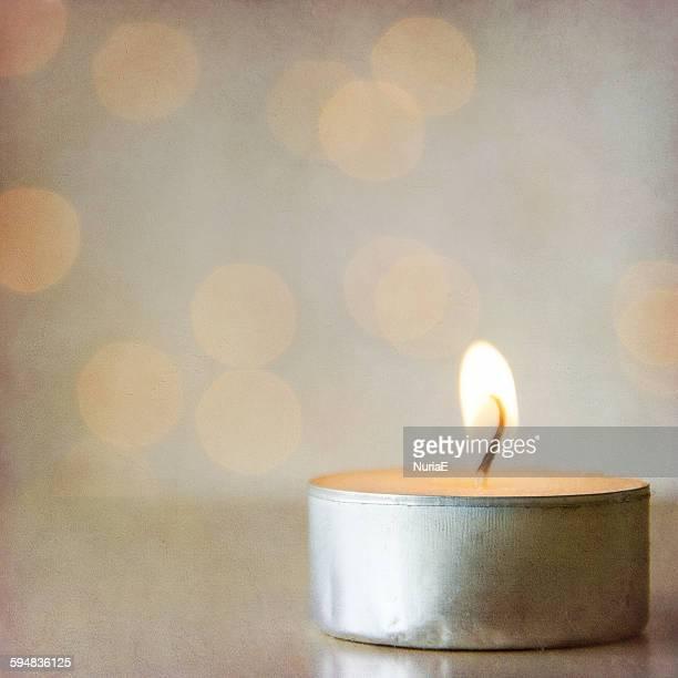 Close-up of a burning tea light