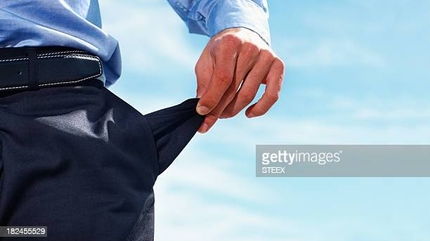Closeup of a business man pulling out empty pocket