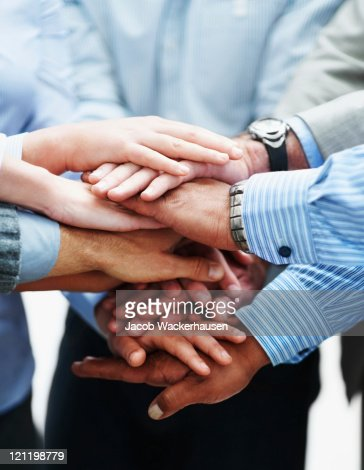 Closeup of a business people with hands together