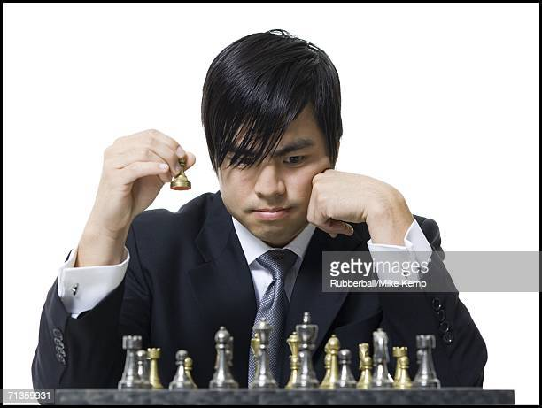 Close-up of a businessman playing chess